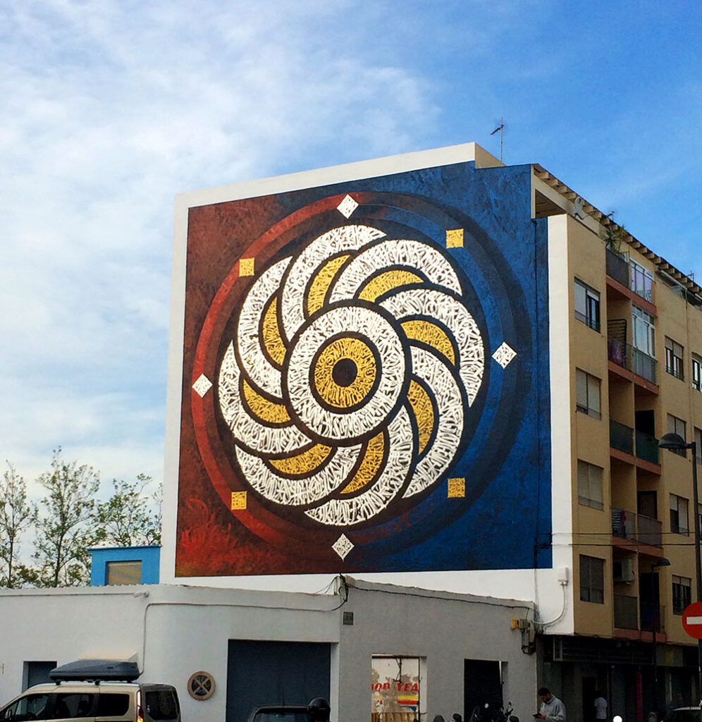 Finished calligraphy art mural by the Mexican Street Artist Said Dokins in Ibiza, for Bloop Street Art Festival