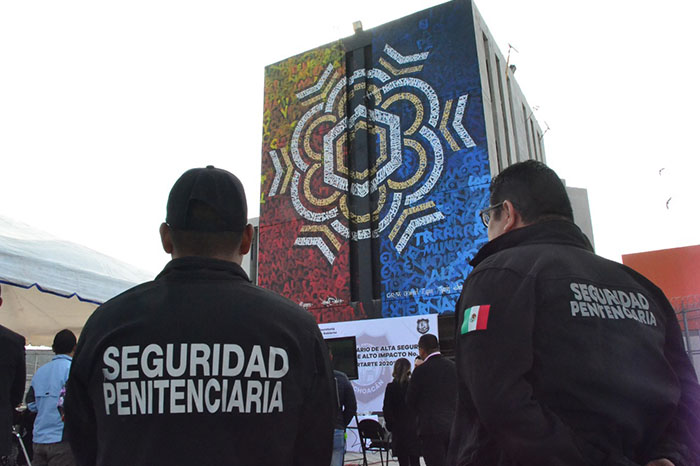 Police officers observing the new calligraphy art mural by mexican artist Said Dokins in the high security prison, Morelia Michoacan