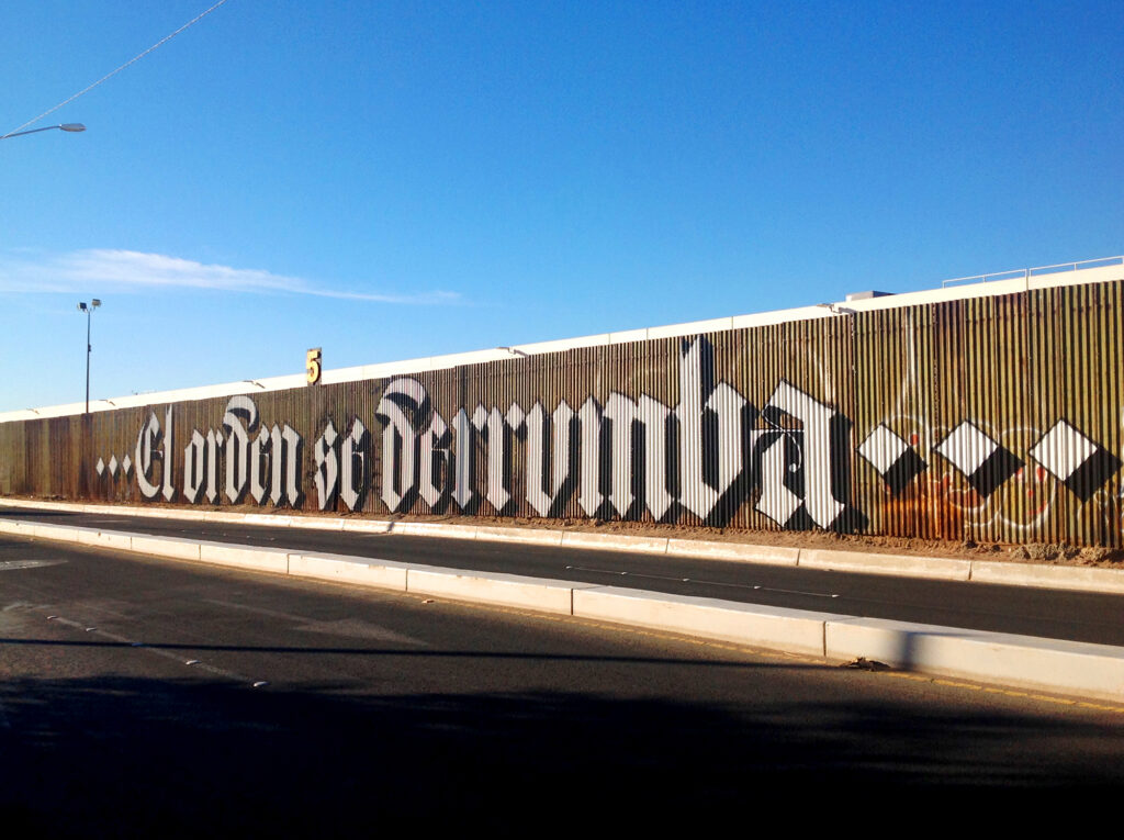 Political graffiti bomb lettering by Said Dokins in borderline MX-USA